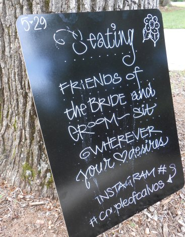 this is post wedding, so it's a little smeared; large chalkboard, liquid chalk