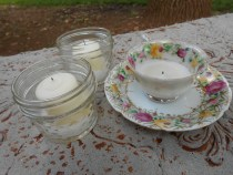 pint-sized diamond pattern mason jars and a few garage sale cups/saucers were the votive candle holders