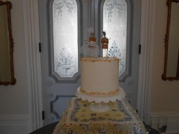 small cake for the couple; cake pops (out of view) for the guests