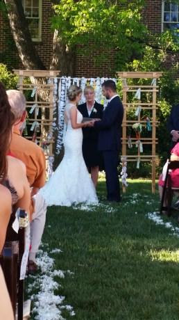 bride and groom with rev. ingrid sagula photo courtesy of eliza hawkins