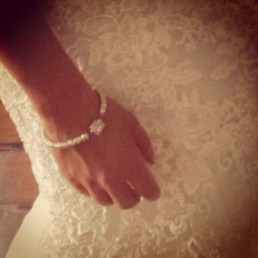 kelley solomon, who is hanna's new cousin on the calvo side, is a jewelry designer and made her a bracelet! aquinnahjewelry.com