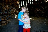 Mama, take our picture in the woodshed.