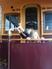 Playing on the street car in Olde Timey Grand Rapids (Public Museum)