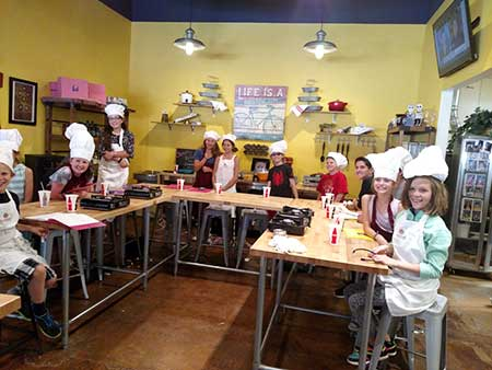 Kids learn to cook at Cinnamons cafe in Albuquerque
