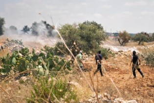 18 July - Villagers and tear gas smoke from Jewish soldiers outside Nil'im ISM