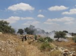 18 July - Villagers from Nil'in with tear gas smoke from Jewish soldiers ISM