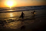 Surfers in the evening