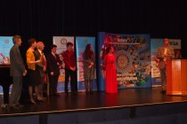 The three adjudicators on stage with the winners and runners up, and the compere (Tony Murray, Rotary Club of Taunton