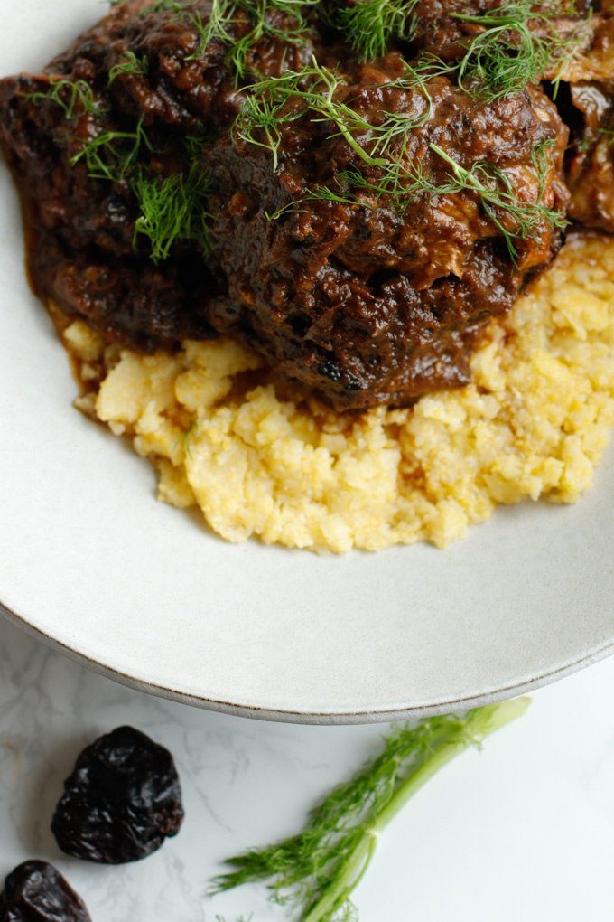 Mediterranean Short Ribs with Polenta - This recipe is super impressive yet really easy to make. It has a surprising secret ingredient that makes all the difference. | circleofeaters.com
