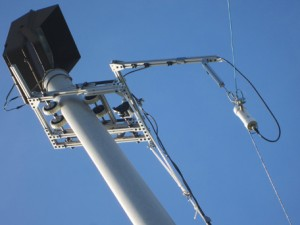 Photo 1: This pole-climbing robot is easy to deploy at a moment's notice. There is no need for a ladder to get emergency communication antennas up high where they can be most effective.