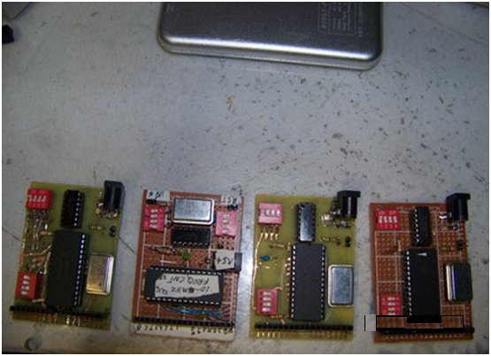 Photo 4: Various versions of Bellerose's present project are shown. The plug-in units are for eight-digit displays. They are based on the 28-pin Intersil ICM 7216D chip with a 10-MHz time base oscillator, a 74HC132 input buffer, and a 74HC390 prescaler to bring the range to 60 MHz. The units' eight-digit displays vary from  1″ to 0.56″ and 0.36″.