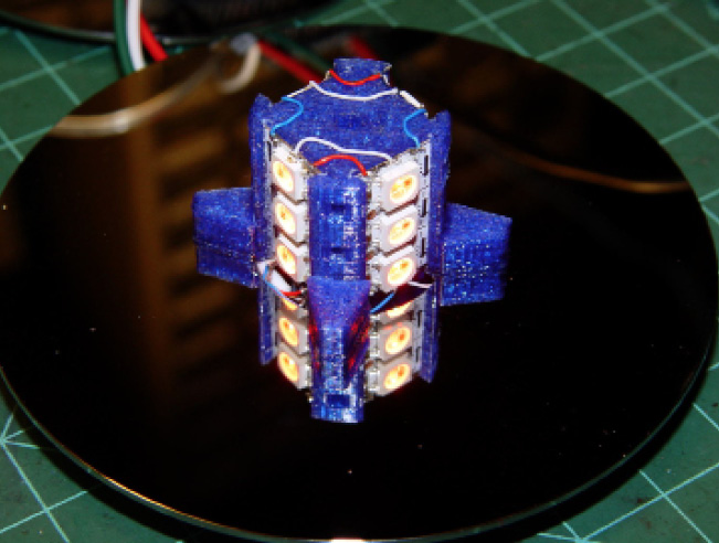 Photo 7  A dozen Neopixels mounted on a plastic pillar inside a stack of recycled hard drive platters got much hotter than I expected. Running them at lower power should suffice until mid-summer.