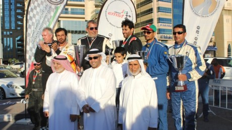 Winners Al Qassimi and Khoury, Sulayem and Morgan and third-placed Omanis Khalid Al      Manji and Said Al Aisiri on the podium , along with Mr Mohamed Bin Saifan      Chairman of the Stewards (right), Sheikh Mohammed Bin Abdullah Al Noaimi, Chairman      Organizing Committee (Centre) and HE Ahmed Al Fardan - Sharjah Sport Council (left)
