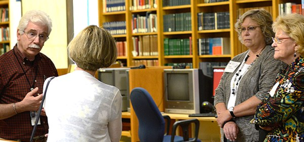 A tour guide speaks to visitors in the History of Medicine Reading Room