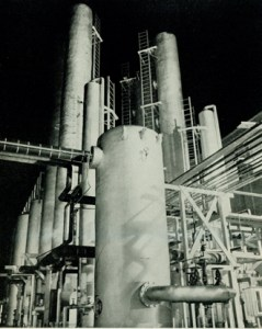 The outside of a penicillin plant featuring many cylindrical towers, tanks, and connecting pipes.