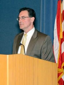 Dr. Craig standing at a podium.
