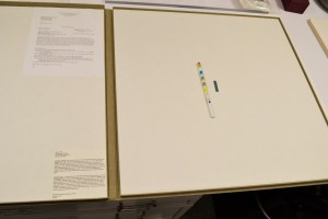 A large open box with testing materials placed in it.