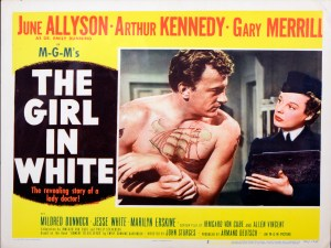 Advertisement for the Girl In White showing a still in which a womain in a uniform consults with an injured sailor.