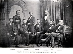 A group of 8 men in suits pose for a formal group portrait.