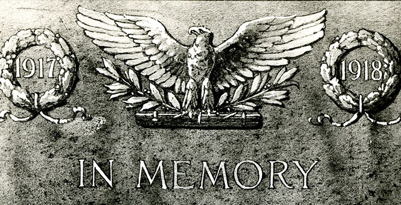A bas-relief plaque featuring an American eagle and a caduceus.