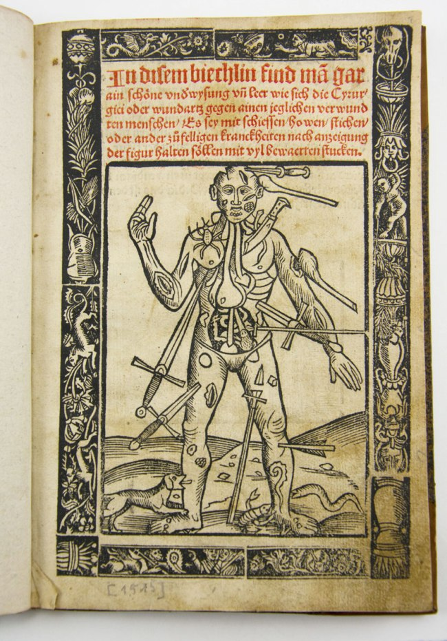 "Title page printed in red and black, with ornamental border; title above ""wound man"" illustration. The figure of a man whose body has been pierced by a variety of weapons swords, knives, arrows, and clubs. He is also being bitten by a dog, a scorpion, and a spider."