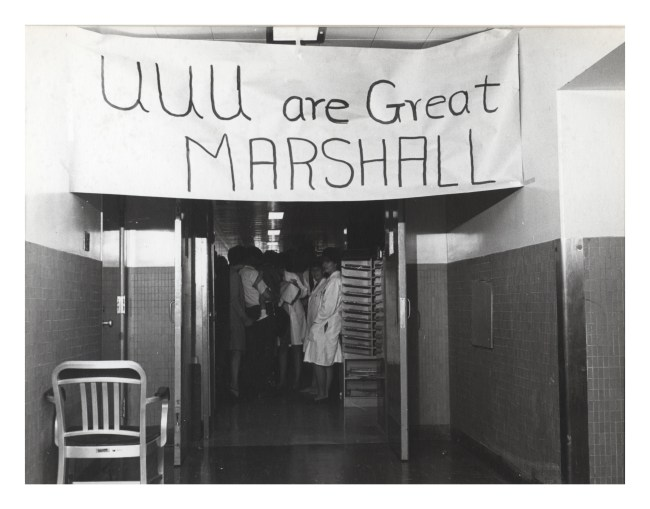 """A banner reading """"UUU are Great Marshall"""" hung in a hallway."""