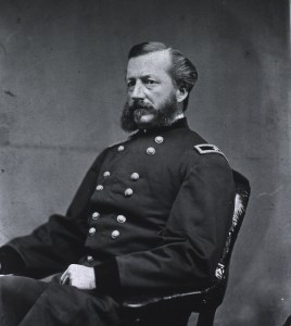 Seated, three-quarter left pose of Joseph K. Barnes, showing arms and left hand.