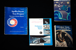 A group of four books related to medicine and spaceflight.