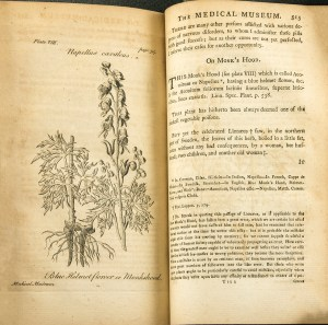 "An open book showing a botanical illustraiton of monkshood and the first page of the article ""On Monk's Hood."""