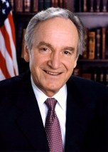 An official portrait of Senator Tom Harkin with flag and books in the background.