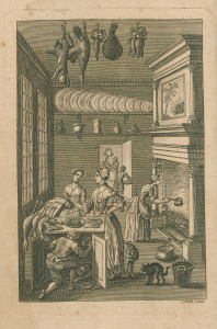Engraving of well dressed people in a kitched, cooking at a fireplace, food, and game are laid out, a dog and cat prowl the floor.