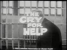 "A still as the title ""The Cry For Help"" pans accross people in jail."