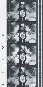 A strip of film showing an animated figure in an army uniform looking down at his insides.