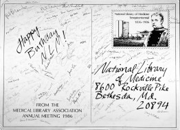 A poster wishing NLM a Happy Birthday covered with signatures.