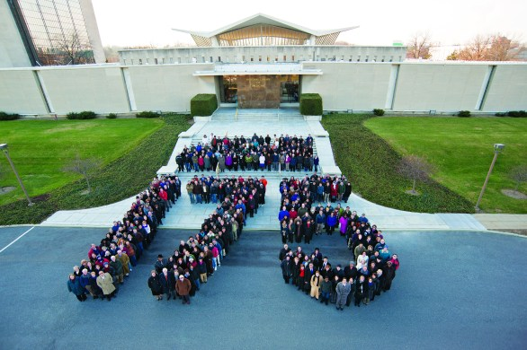 Staff form the number 175 on the steps of the Library.
