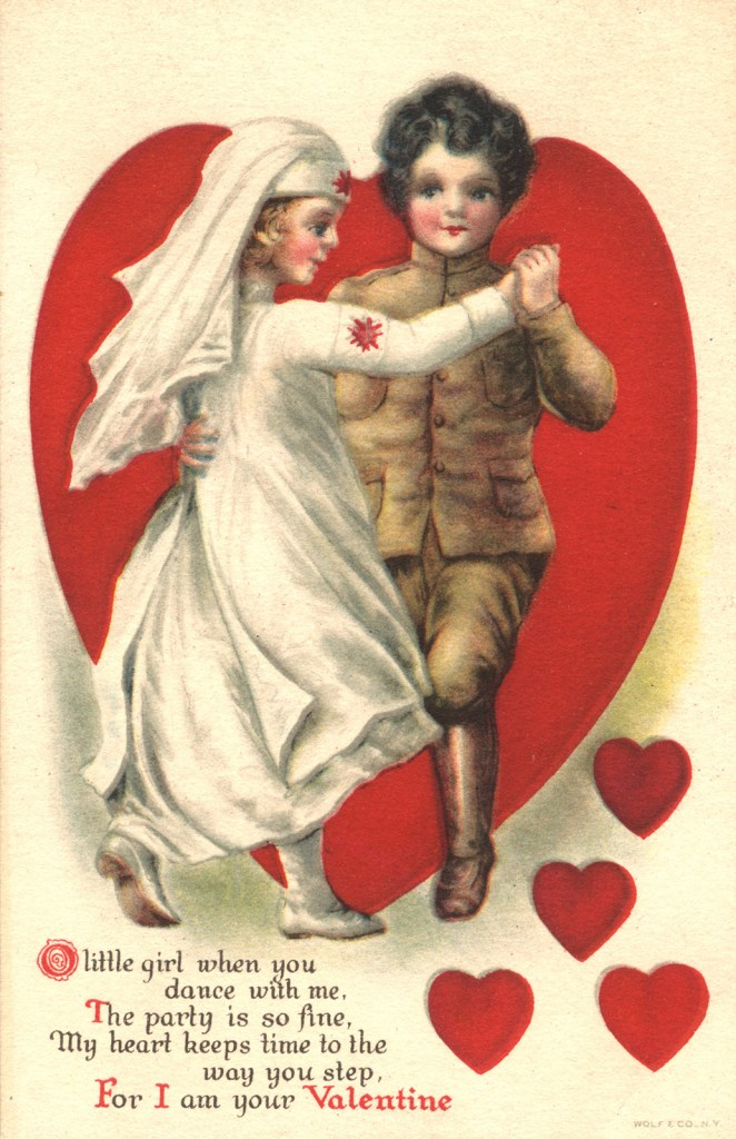 Postcard featuring two children, a boy and a girl, dancing. They are dressed up as a nurse and a soldier.