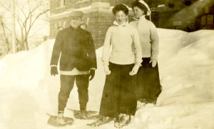 Cornelia Mercer and 2 friends, a man and a woman, are outside in the snow, skiing