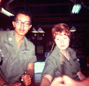 A woman and a man in uniform, working in a field hospital.