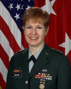 An official portrait in uniform in front of an American flag.