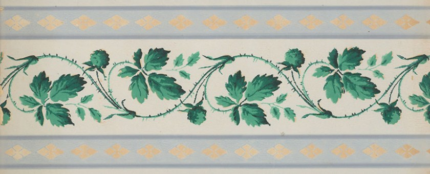 A vining pattern of green leaves and flowers.