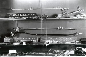 Photo of a display of endoscopic instruments and name placards for Leonidas H. Berry, MD