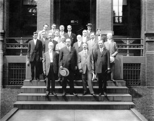 """Army Medical Library staff standing on the front steps of the """"Old Red Brick."""""""