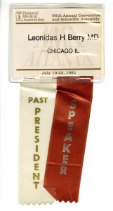 Laminated conference badge with two ribbons attached