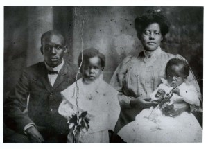 An Afircan American man and woman sit with two African American boys