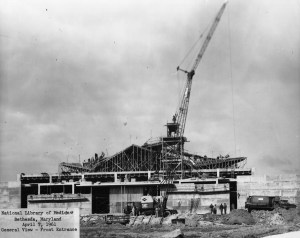 Black and white photograph of library under construction.