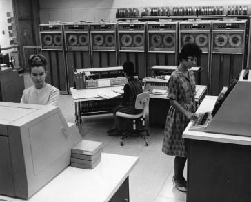 Photograph of three women working.
