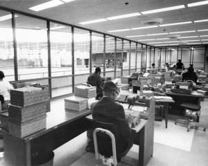 Photograph of staff sitting at desks.