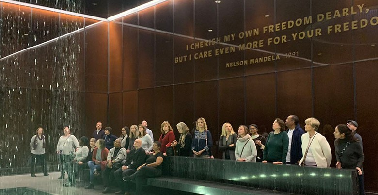 A group of people gathered in the contemplation room at the NMAAHC.