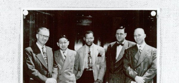Photograph of a group of men in suits.