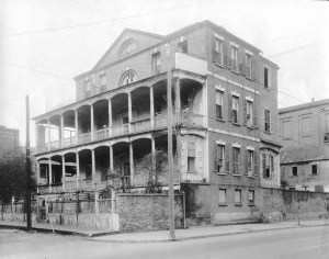 Exterior view of the front and right side of Doctor Samuel Henry Dickson's house on Hudson Street in Charleston, South Carolina. The house has three levels and a basement area.